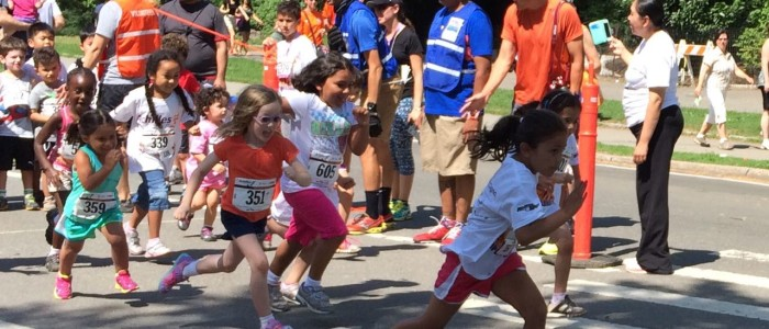 Young girls run at the Achilles Hope and Possibility 2014 race events in New York Central Park.